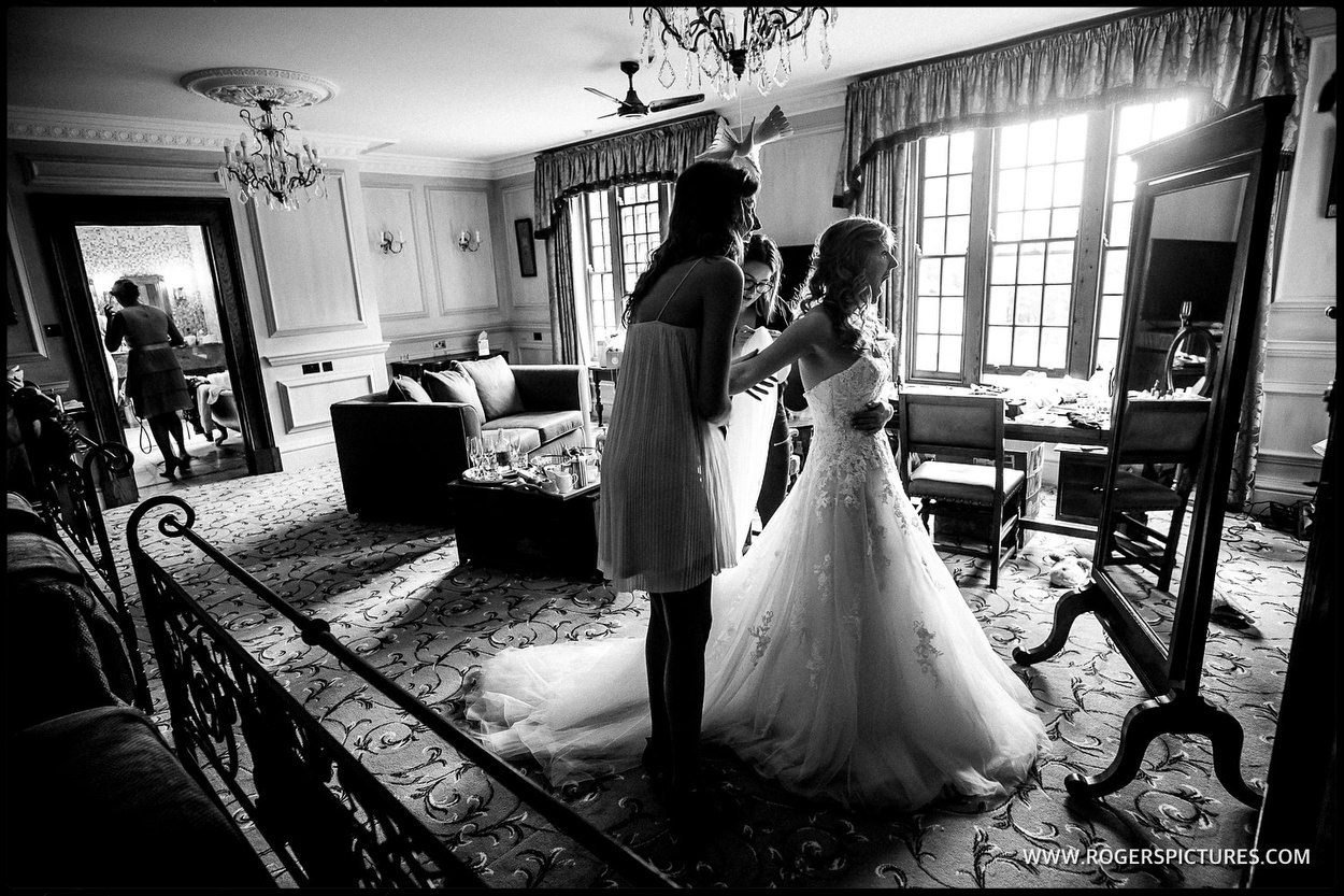 Documentary wedding photographer captures bride in her wedding dress