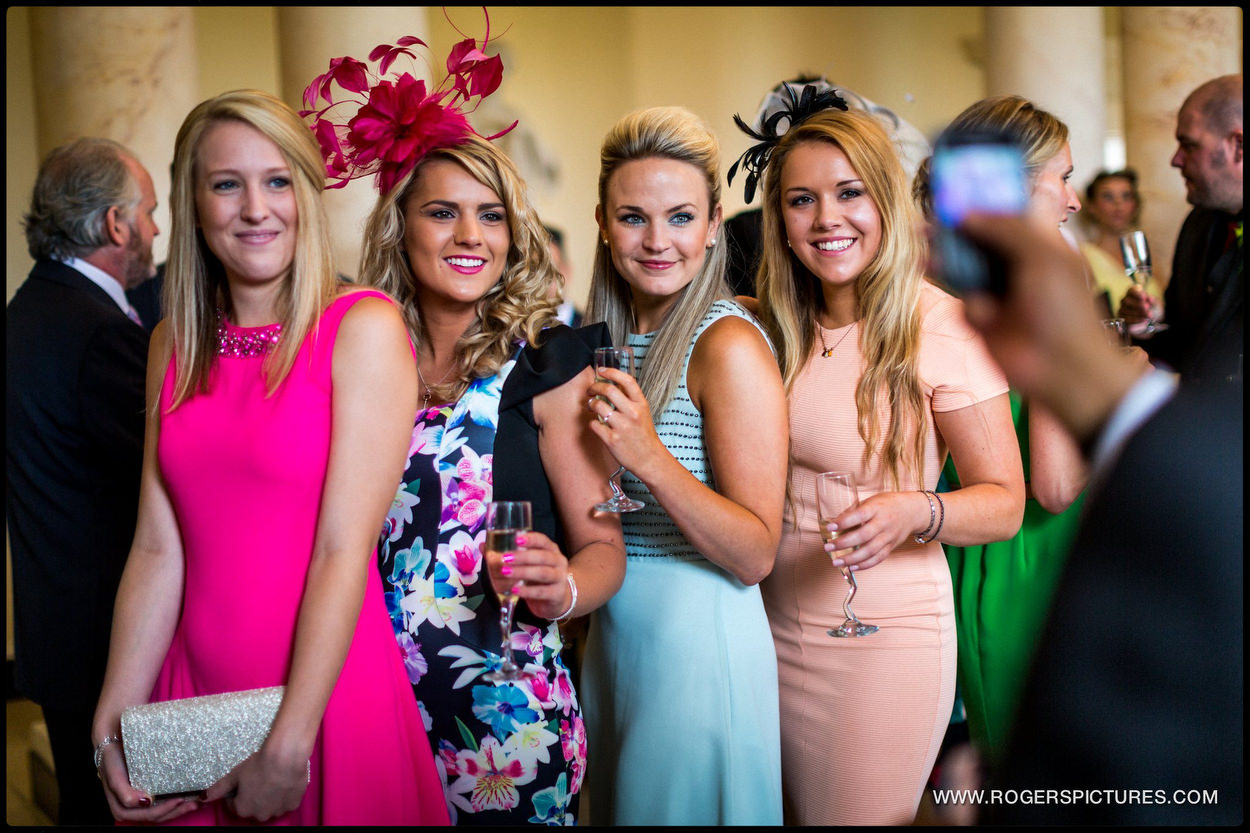 Guests in dresses at Botleys Mansion wedding
