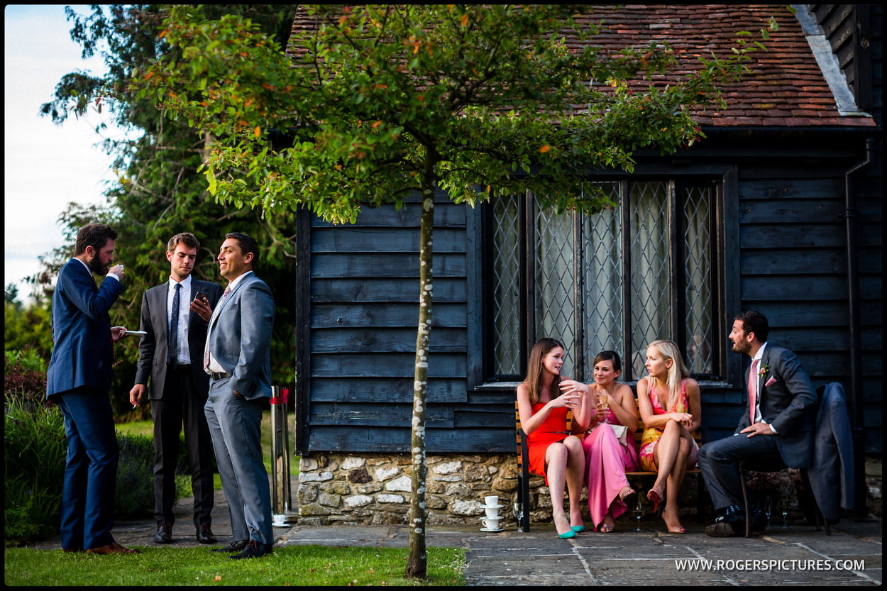 Split composition of wedding guests at an outdoor ceremony