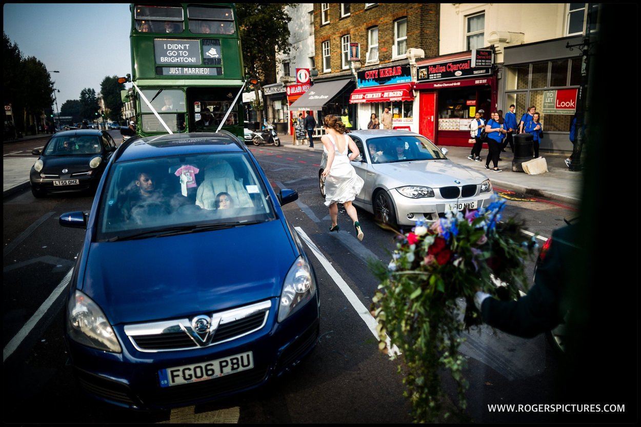 Bride running between wedding busses in London