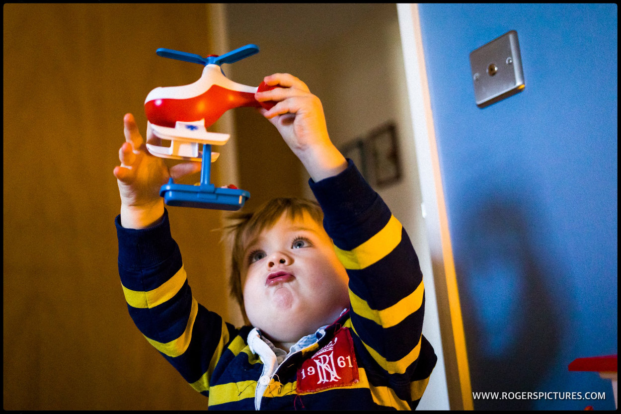 Youngster playing with toy helicopter