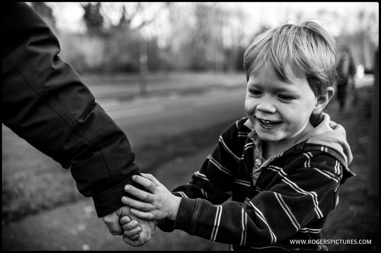 Son holding his dad's hand