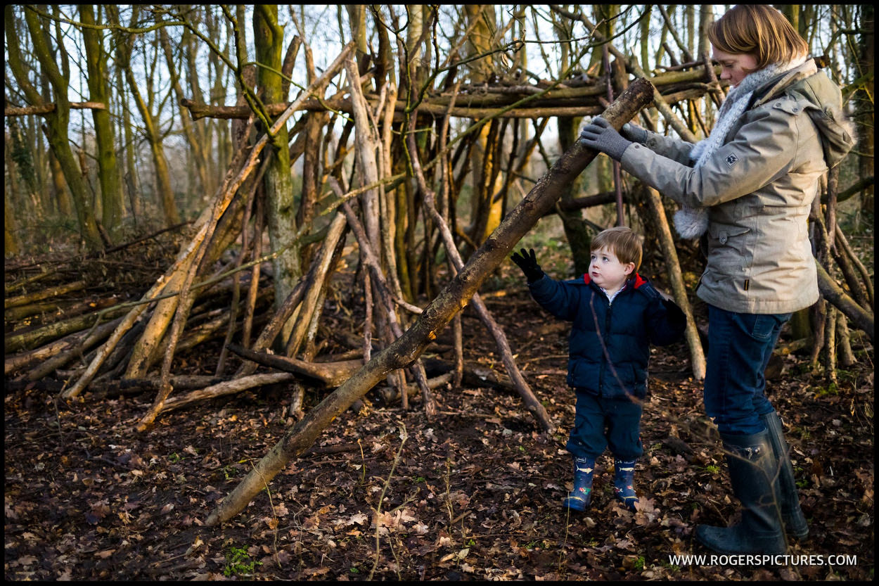 Family building a den