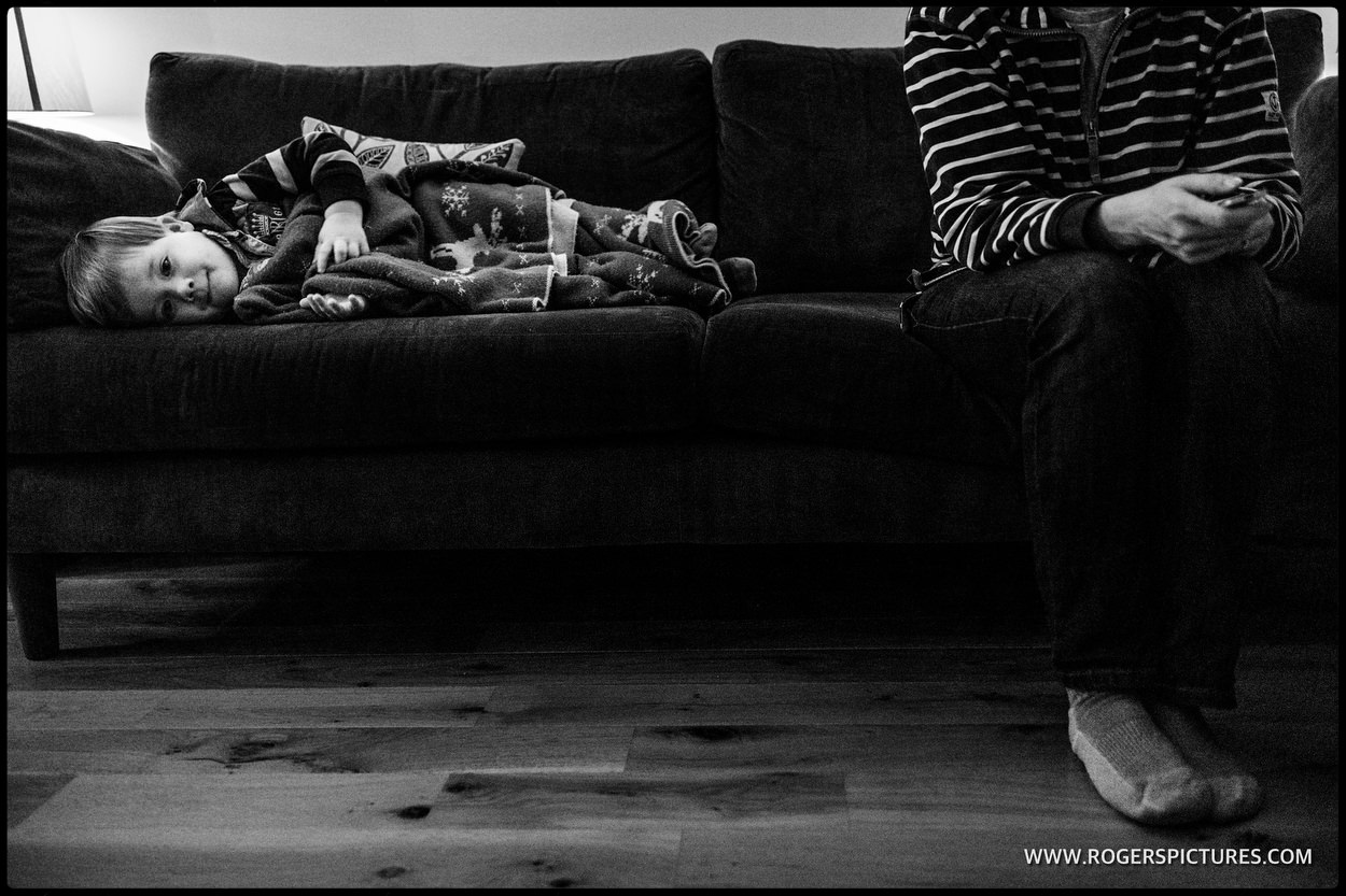 Boy lying on a sofa