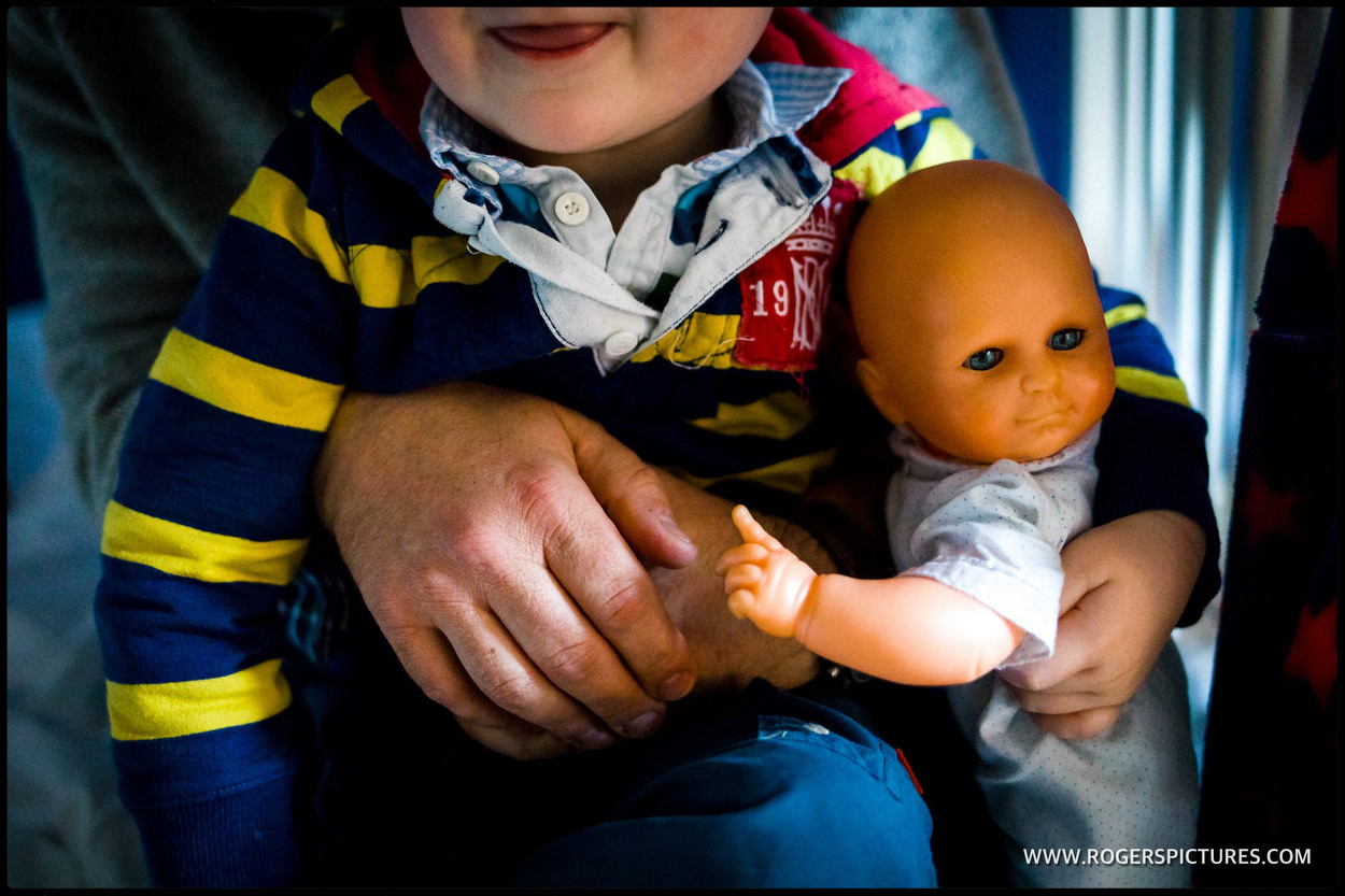 toddler with a baby doll