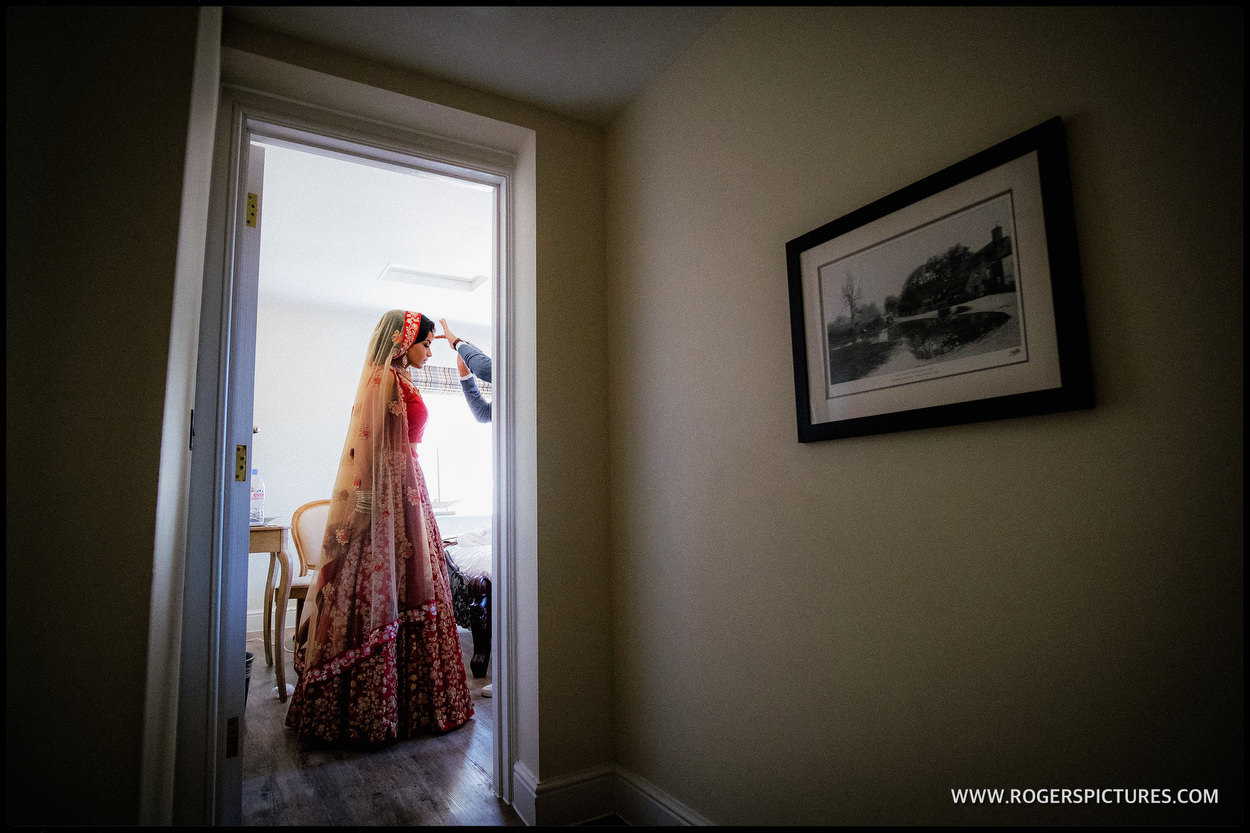 Bride framed in doorway at Froyle Park