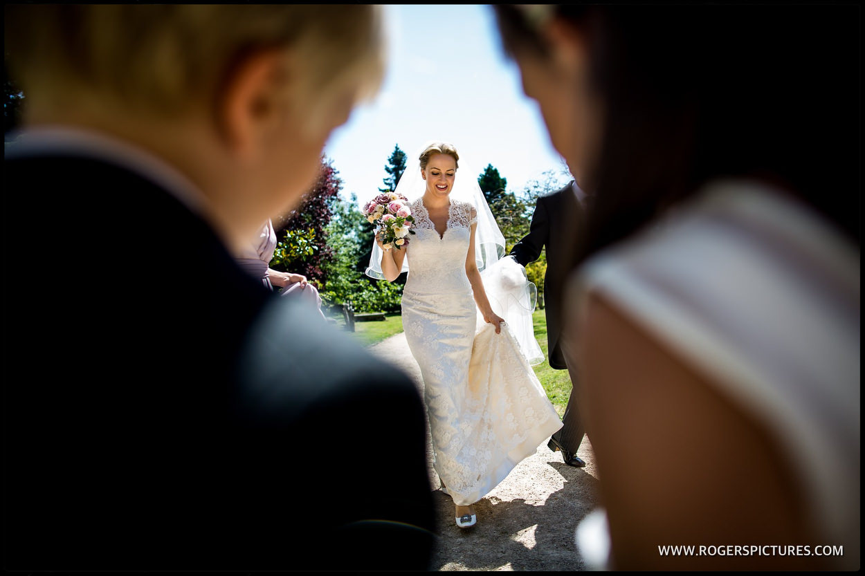 A bride arrives at Boxgrove Priory in Sussex
