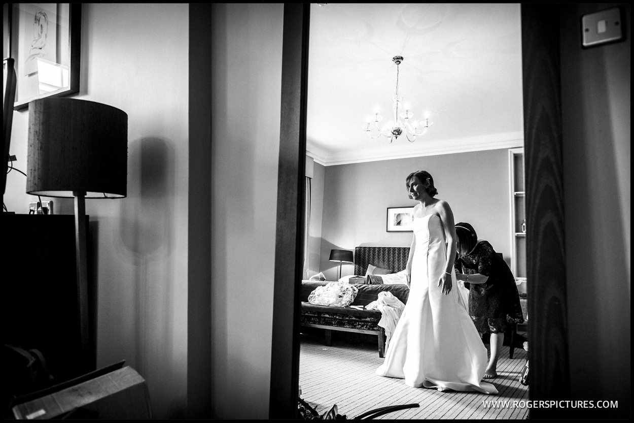 Bride framed in a doorway at Gorse Hill before getting married