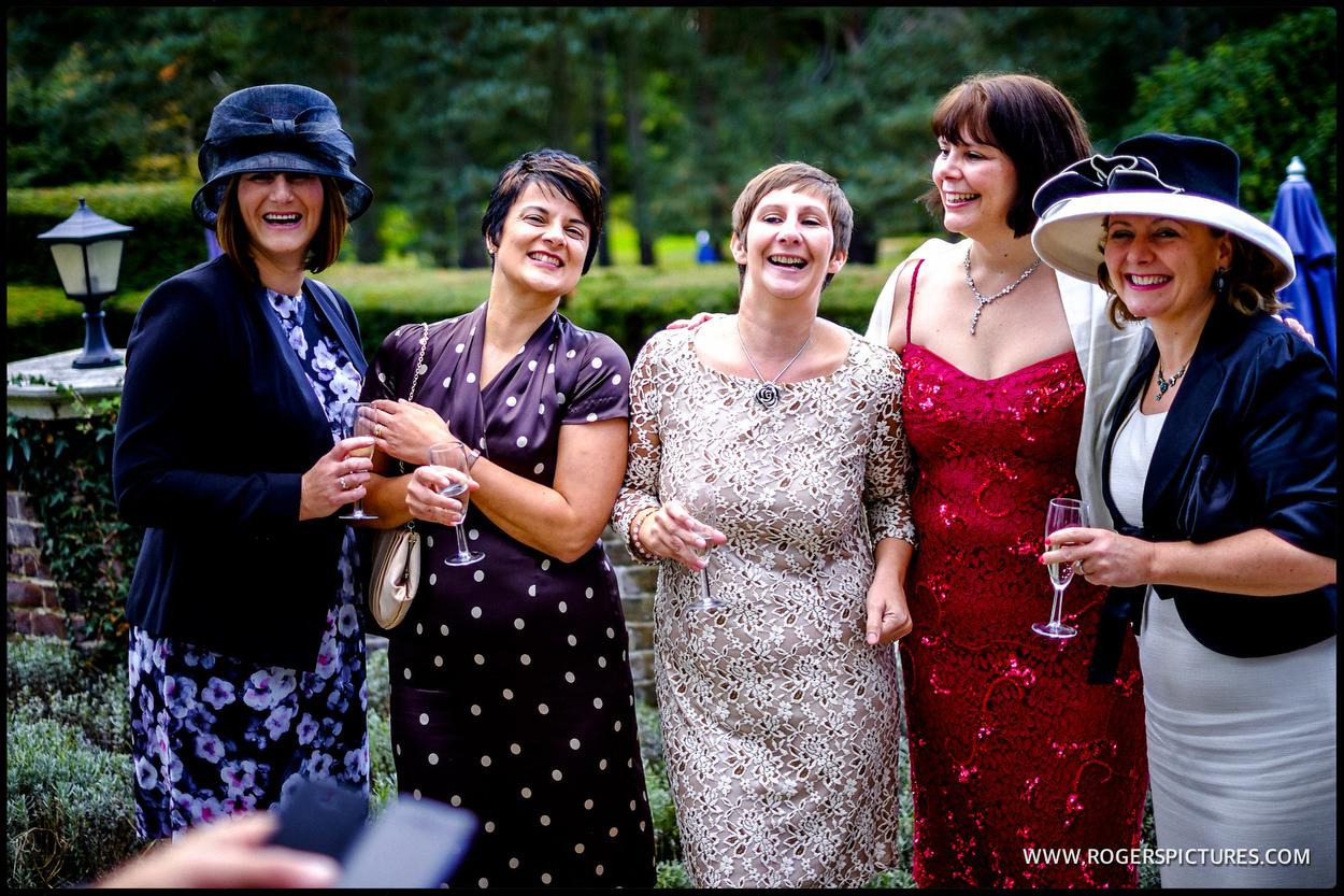 Wedding guests enjoying a reception in Surrey