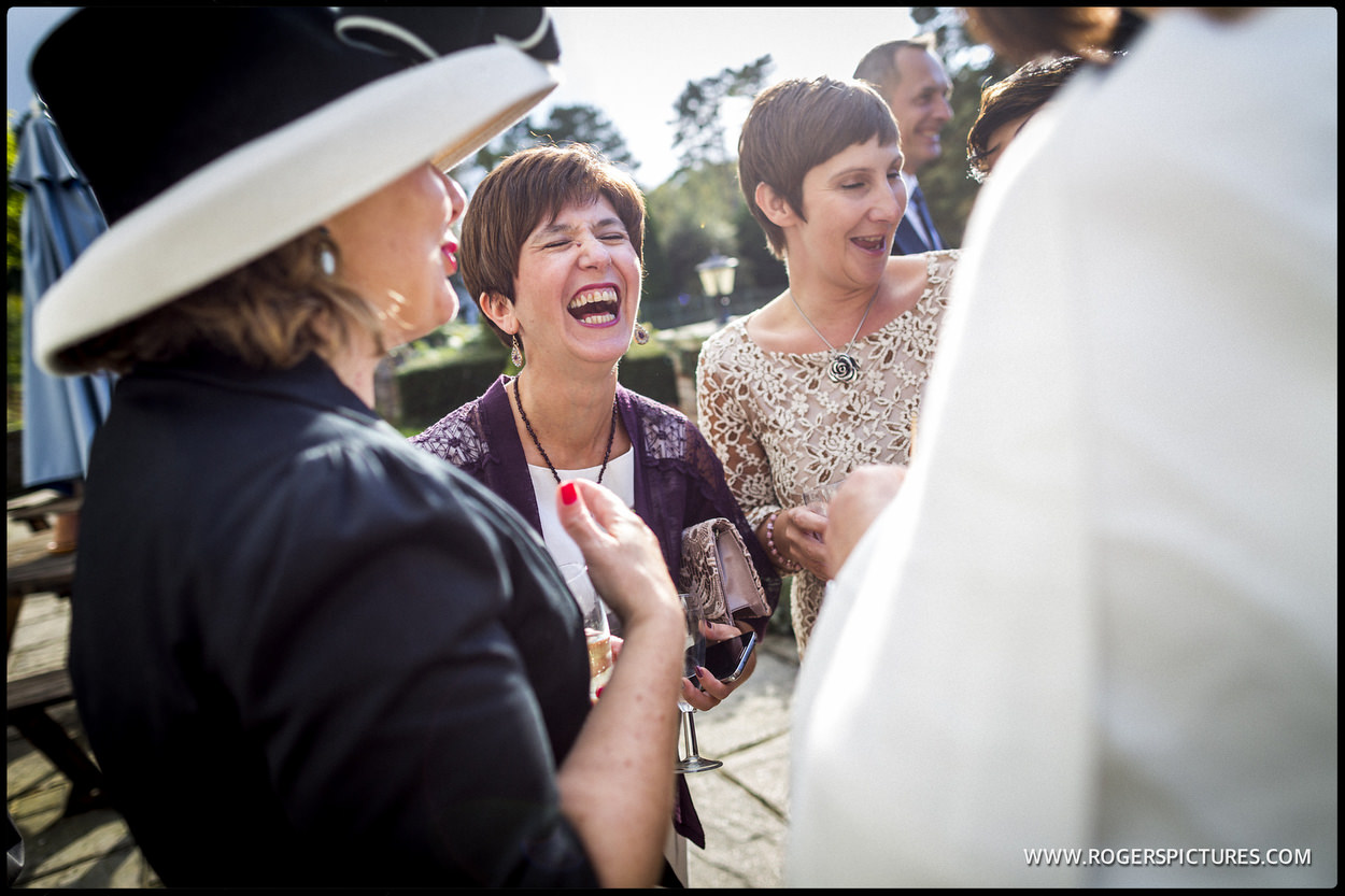 Laughing guests at a wedding