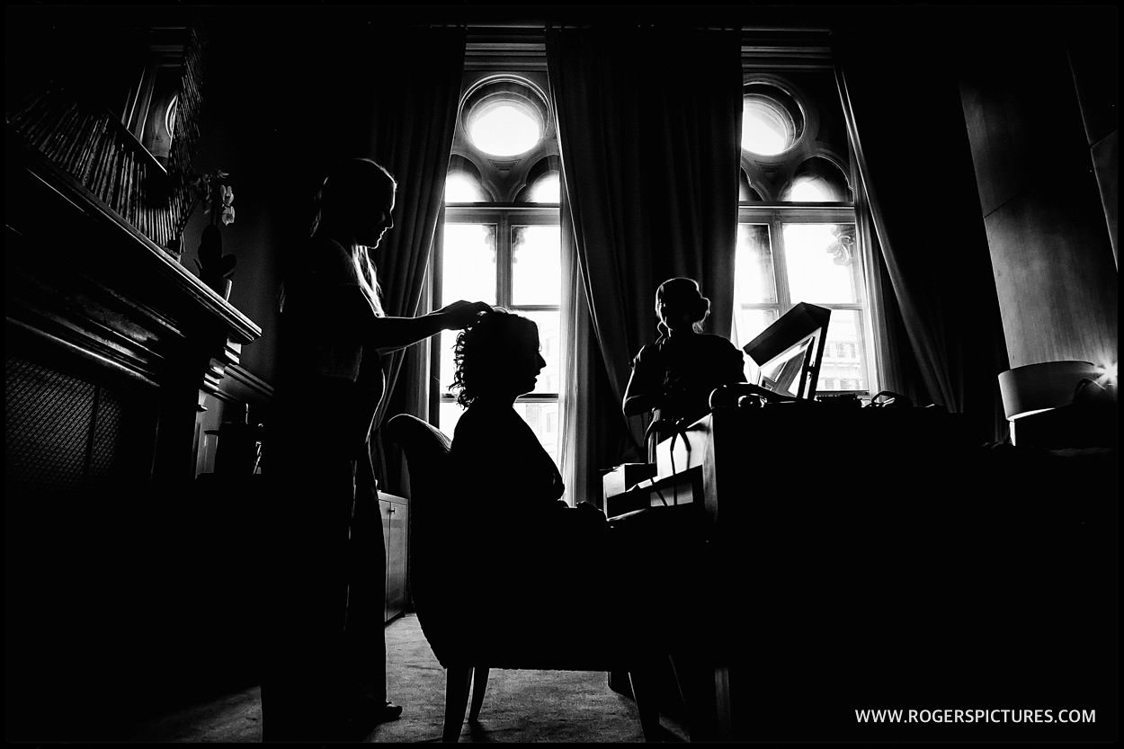 Black and white silhouette of bride preparation