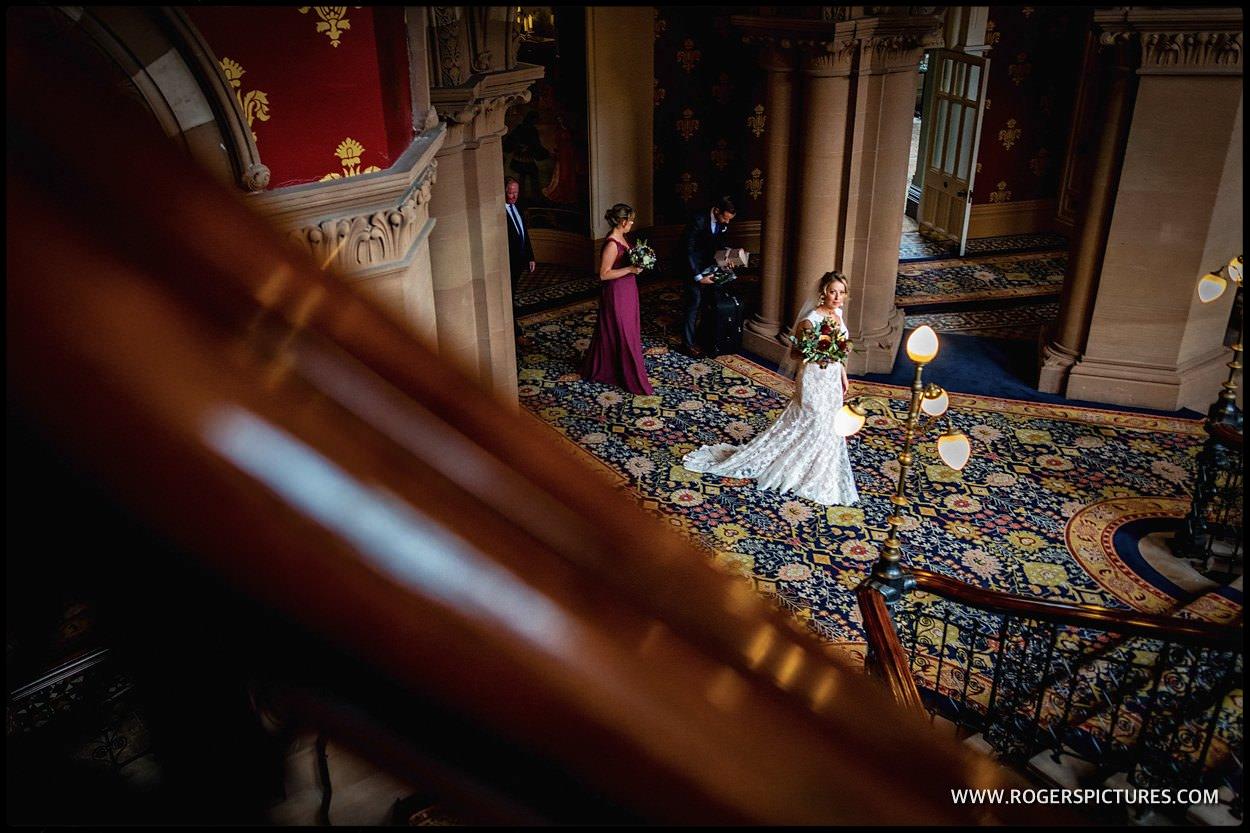Bride in stairway of St Pancras Hotel