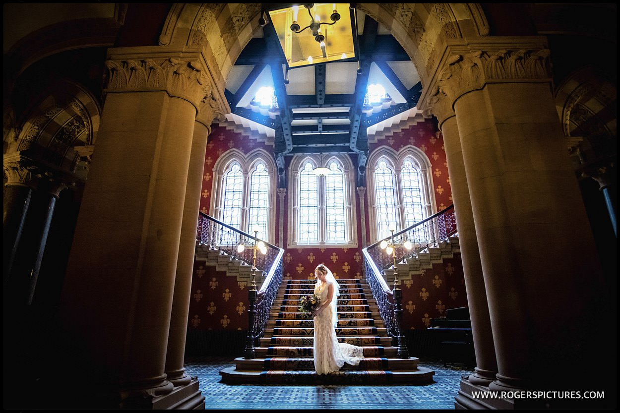Bride on Spice Girls wannabe staircase at St Pancras Hotel London