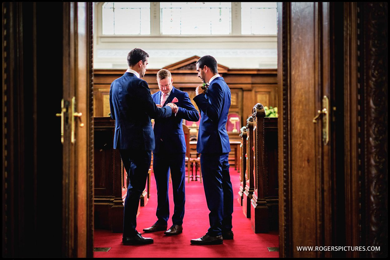Groom and groomsmen wake in council chamber of Islington town Hall