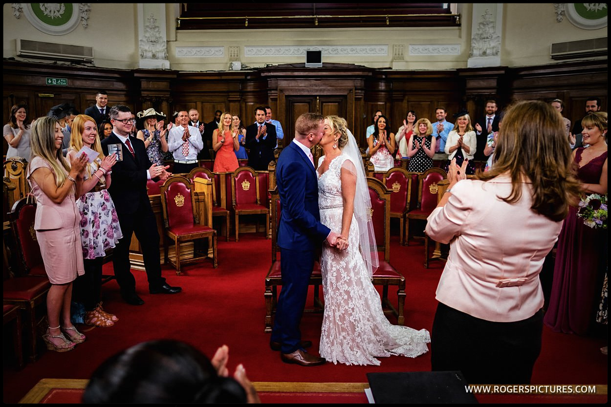 First kiss after London town Hall wedding
