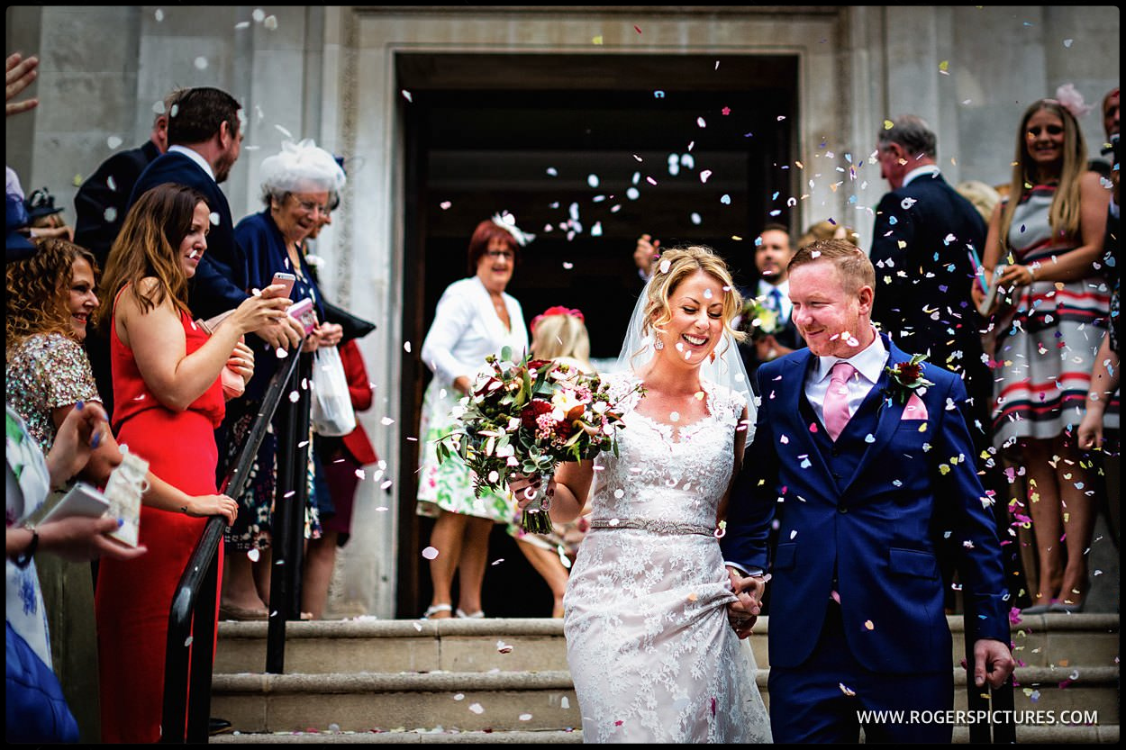 Documentary photograph of bride and groom outside Islington town Hall