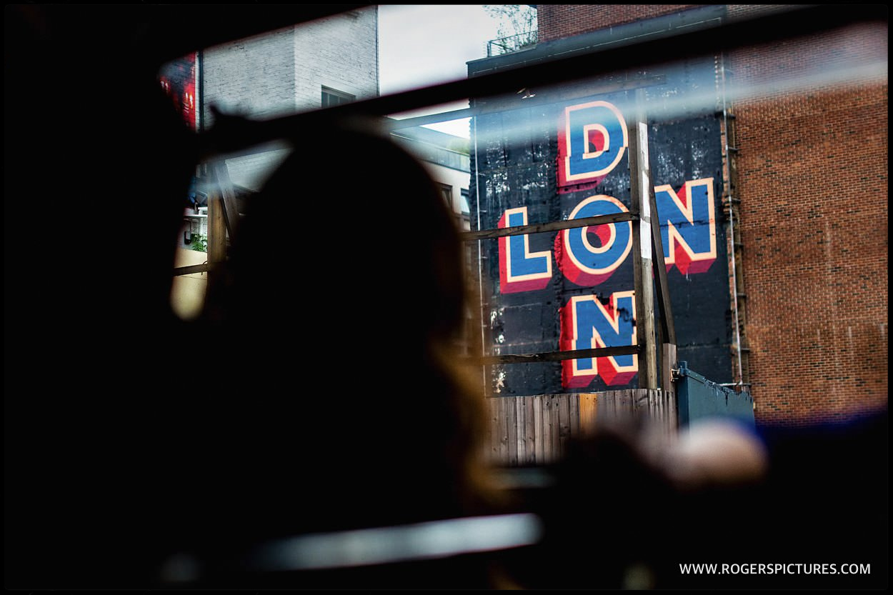 London sign seen through double-decker bus