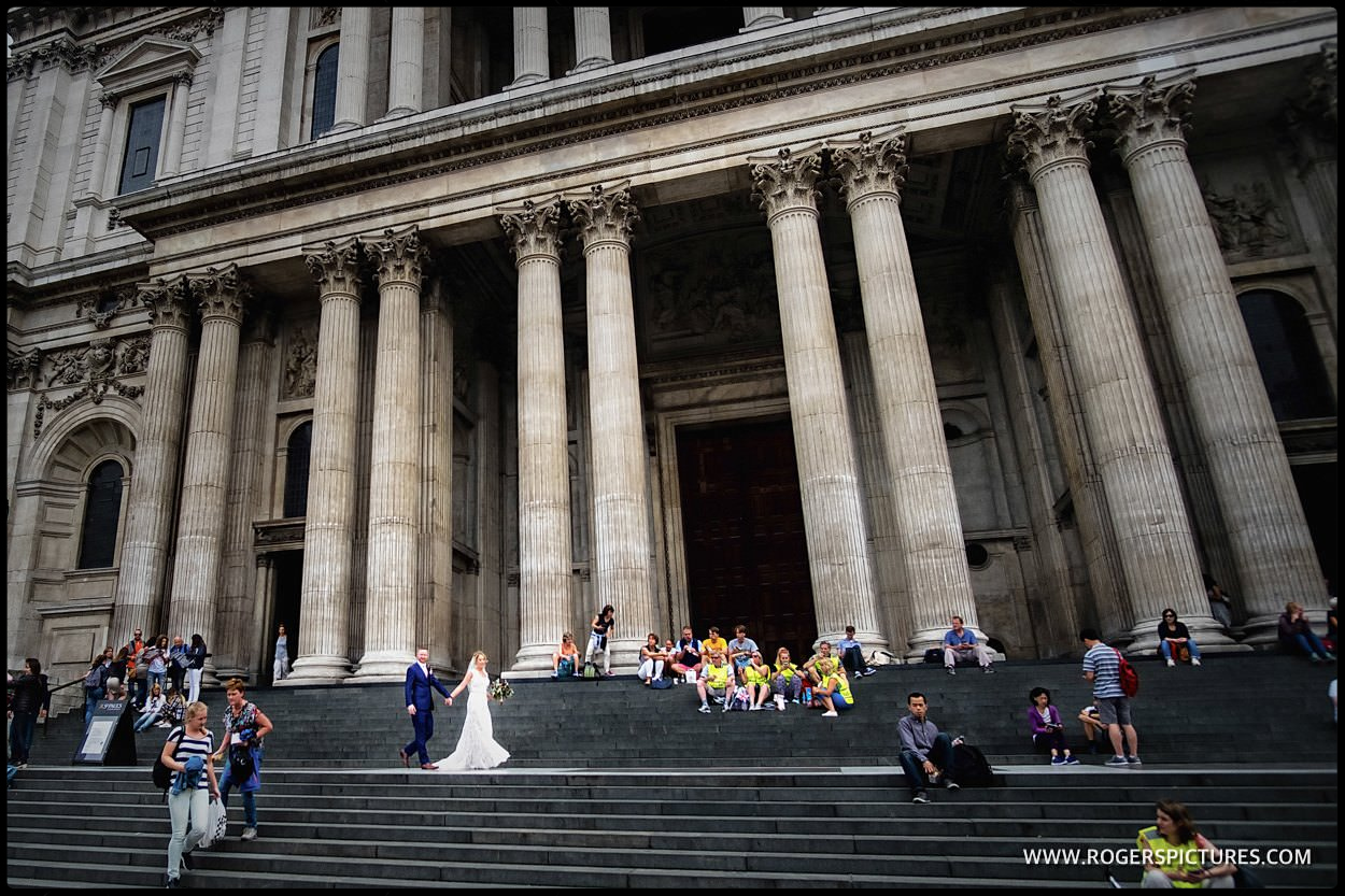 Bride and groom on the steps of St Paul's Cathedral in London