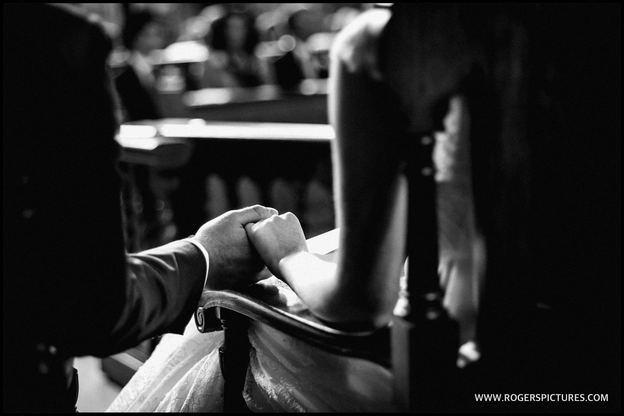 Bride and groom hold hands during a London wedding