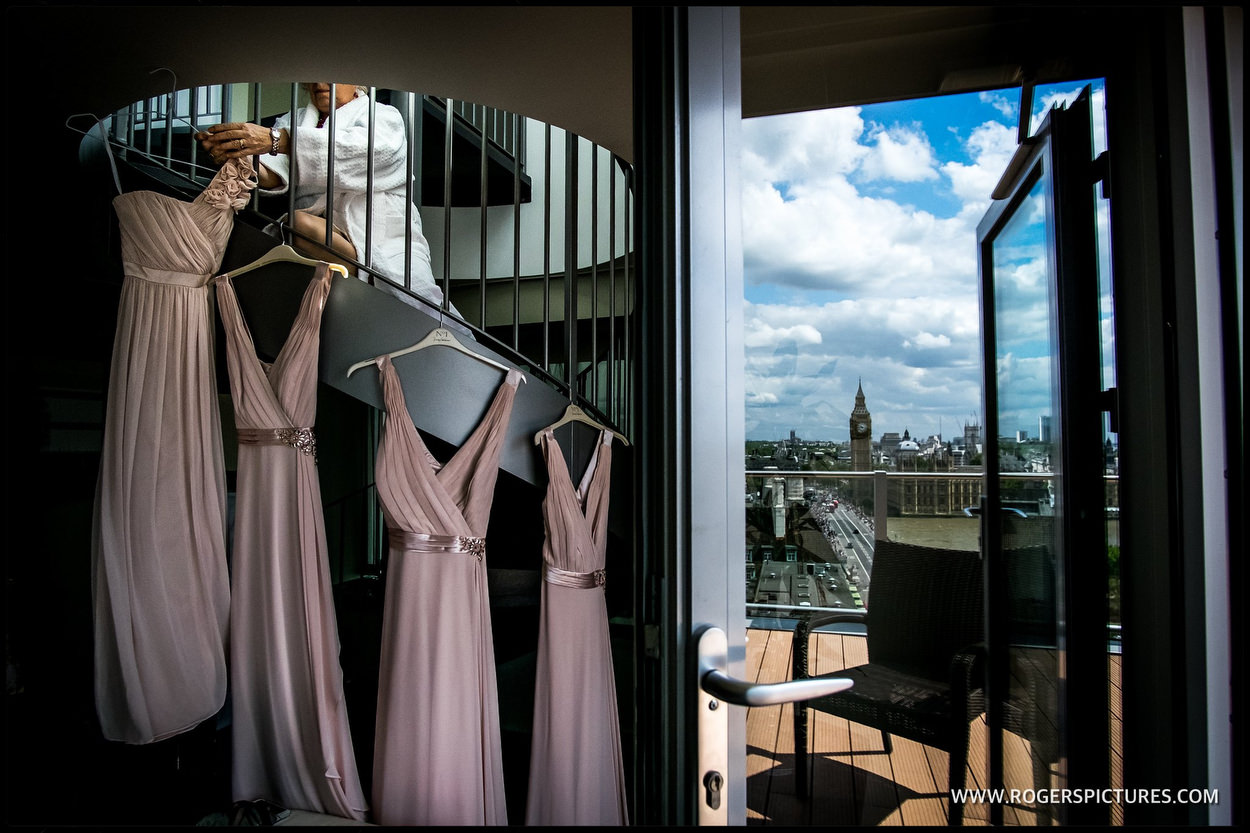 Bridesmaids dresses hang with Big Ben and parliament in the background