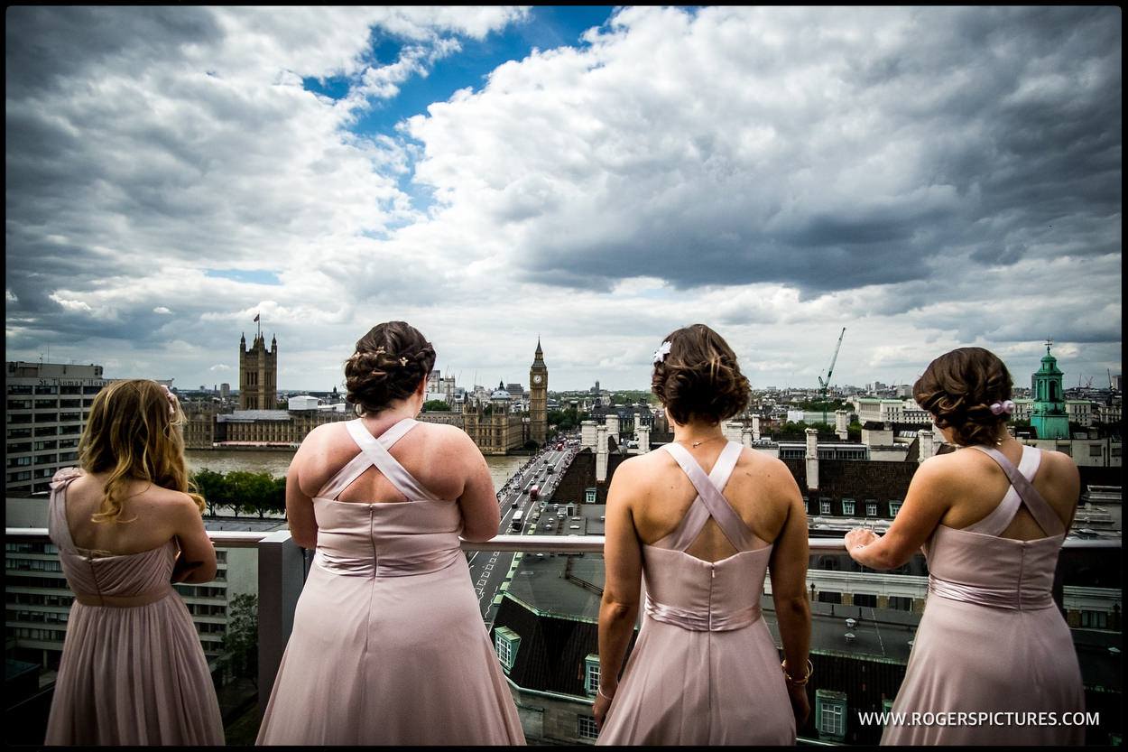 Bridesmaids look out over parliament and big ben before a London wedding