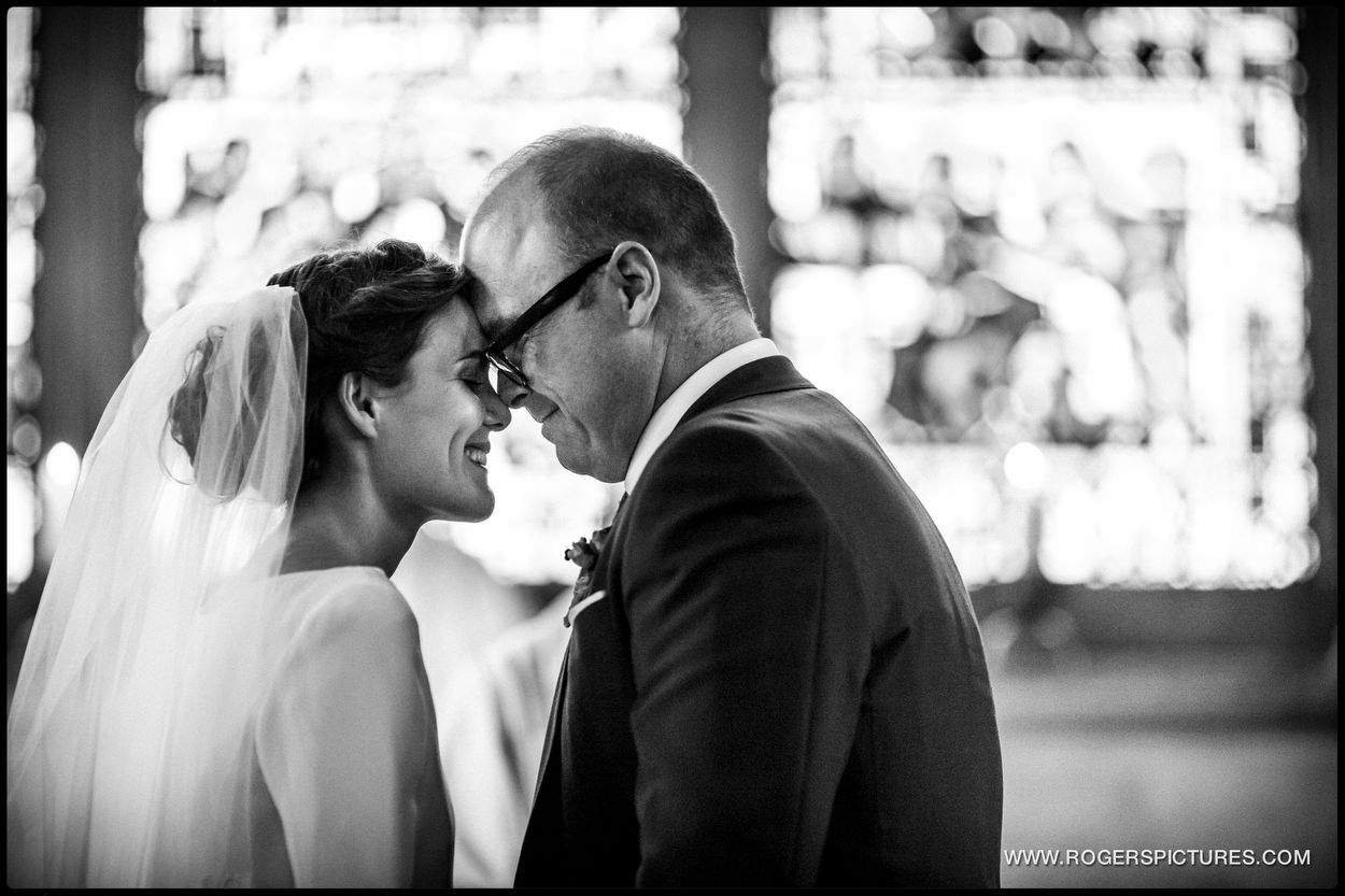 Black and white photo pf bride and groom at St Etheldreda's Church Wedding