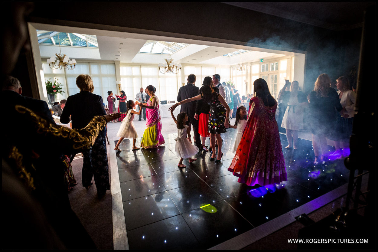 Guests on the dancefloor at a hotel wedding in St Albans in Hertfordshire