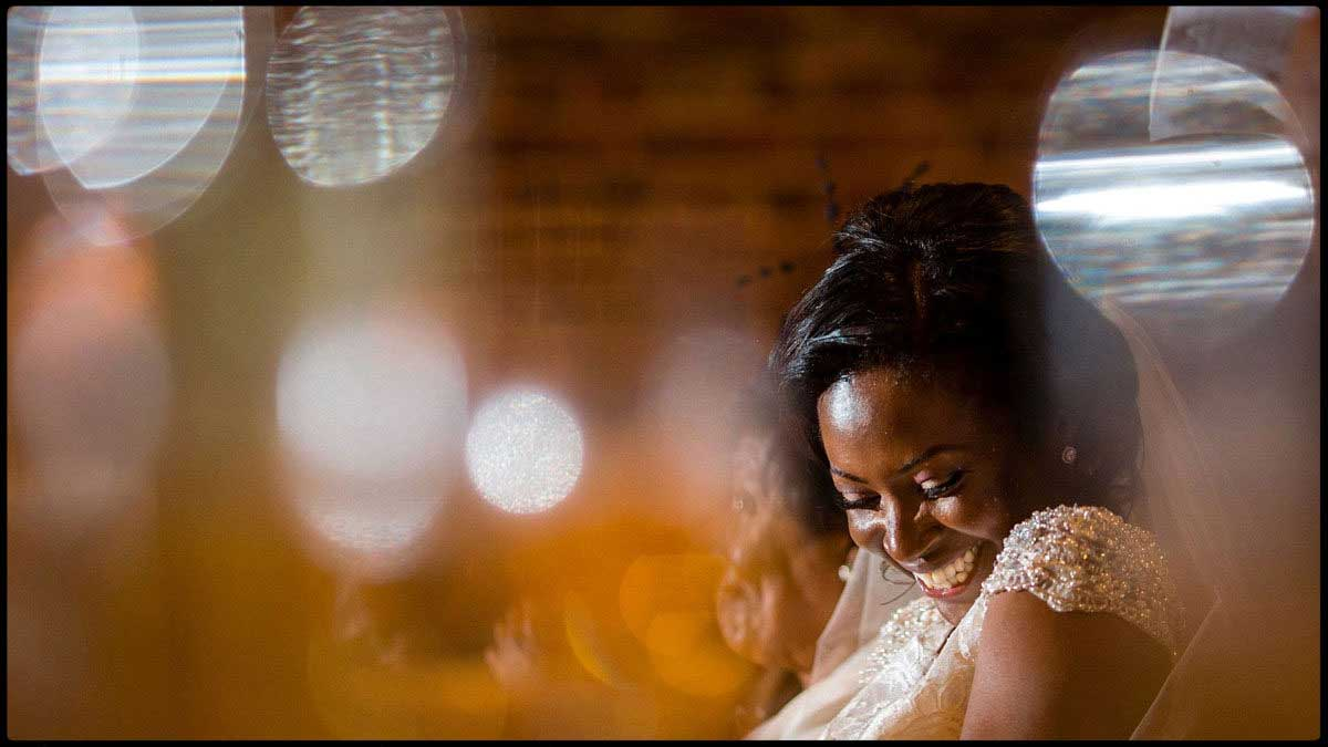 laughing bride during the wedding speeches best wedding photography