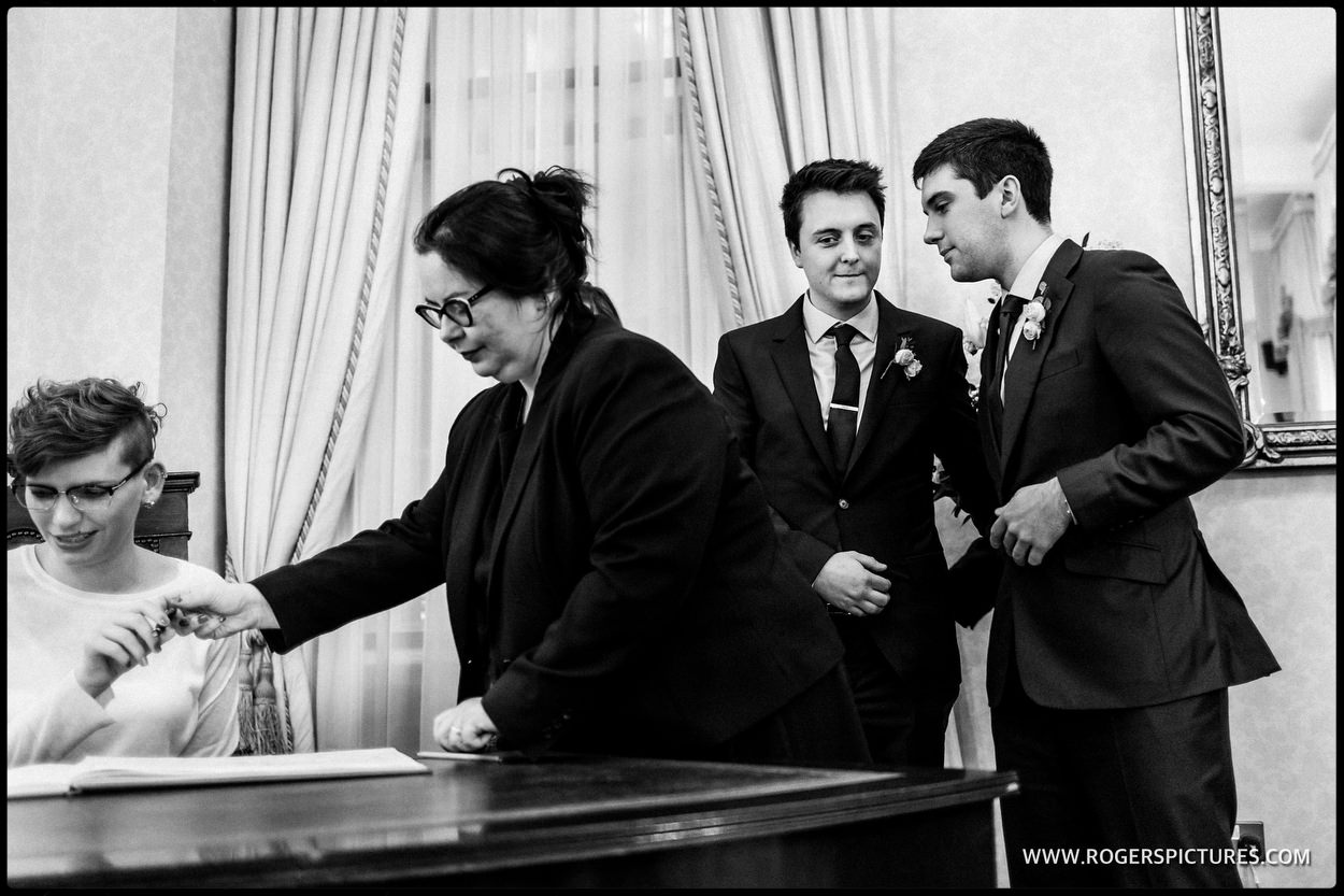 Groom and best man during register signing at Chelsea or Town hall