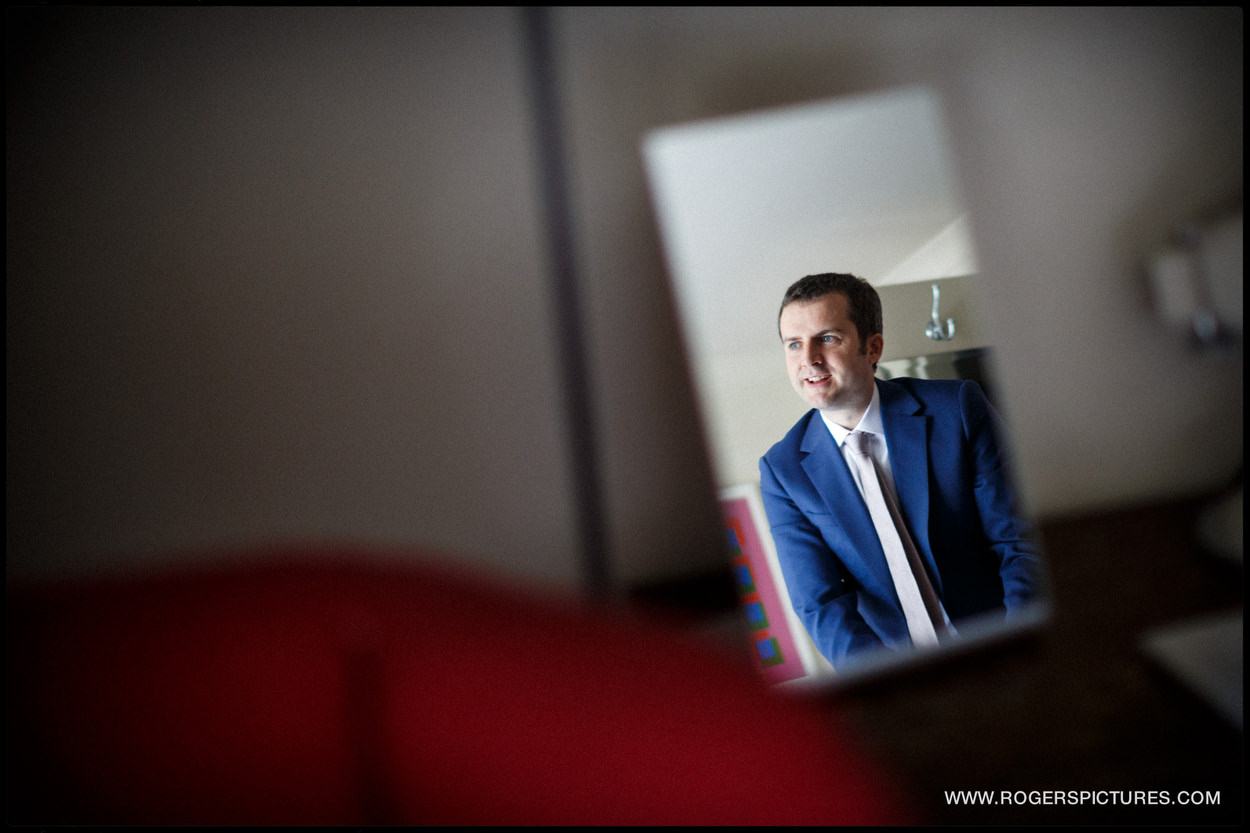 Groom reflected in a mirror