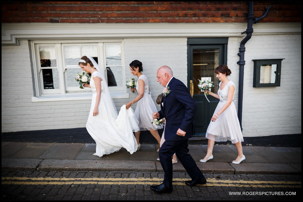 Bride and bridesmaids walk to the town Hall in Rye