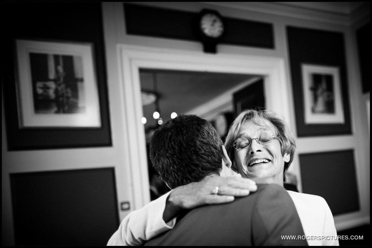Smiles and hugs from a wedding guest