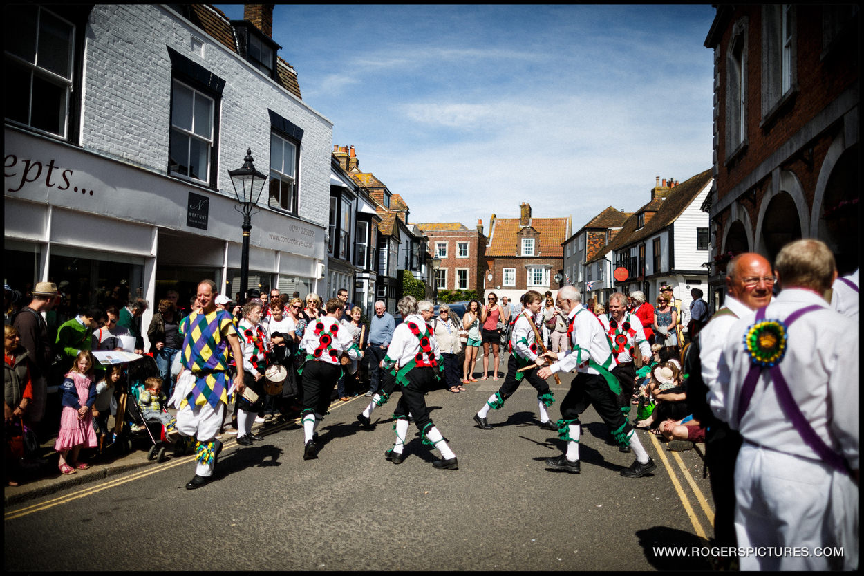 Morris dancers in Rye outside the Town Hall in the sun
