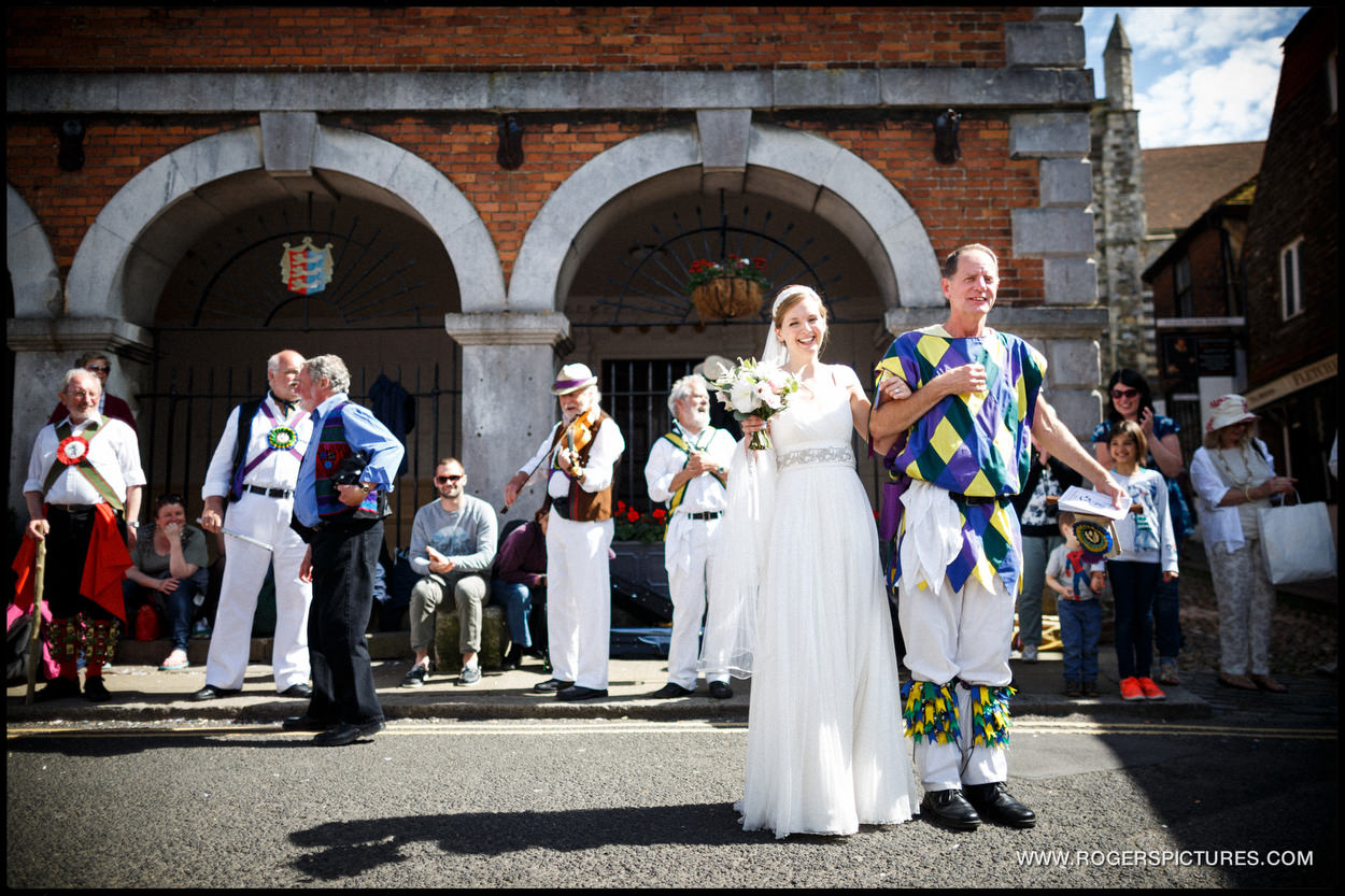 Bride with Morris Dancers outside the Town Hall in Rye