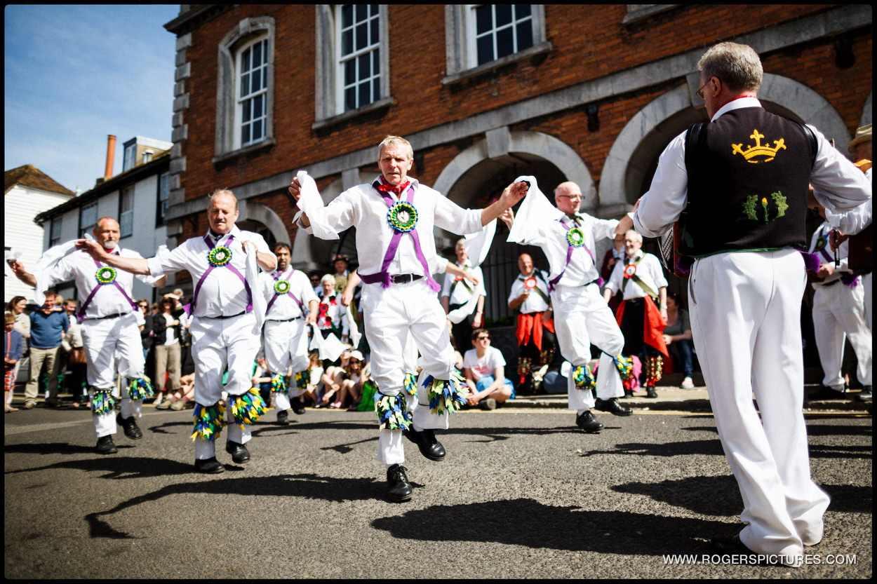 Morris Men dancing to music at a wedding in Rye