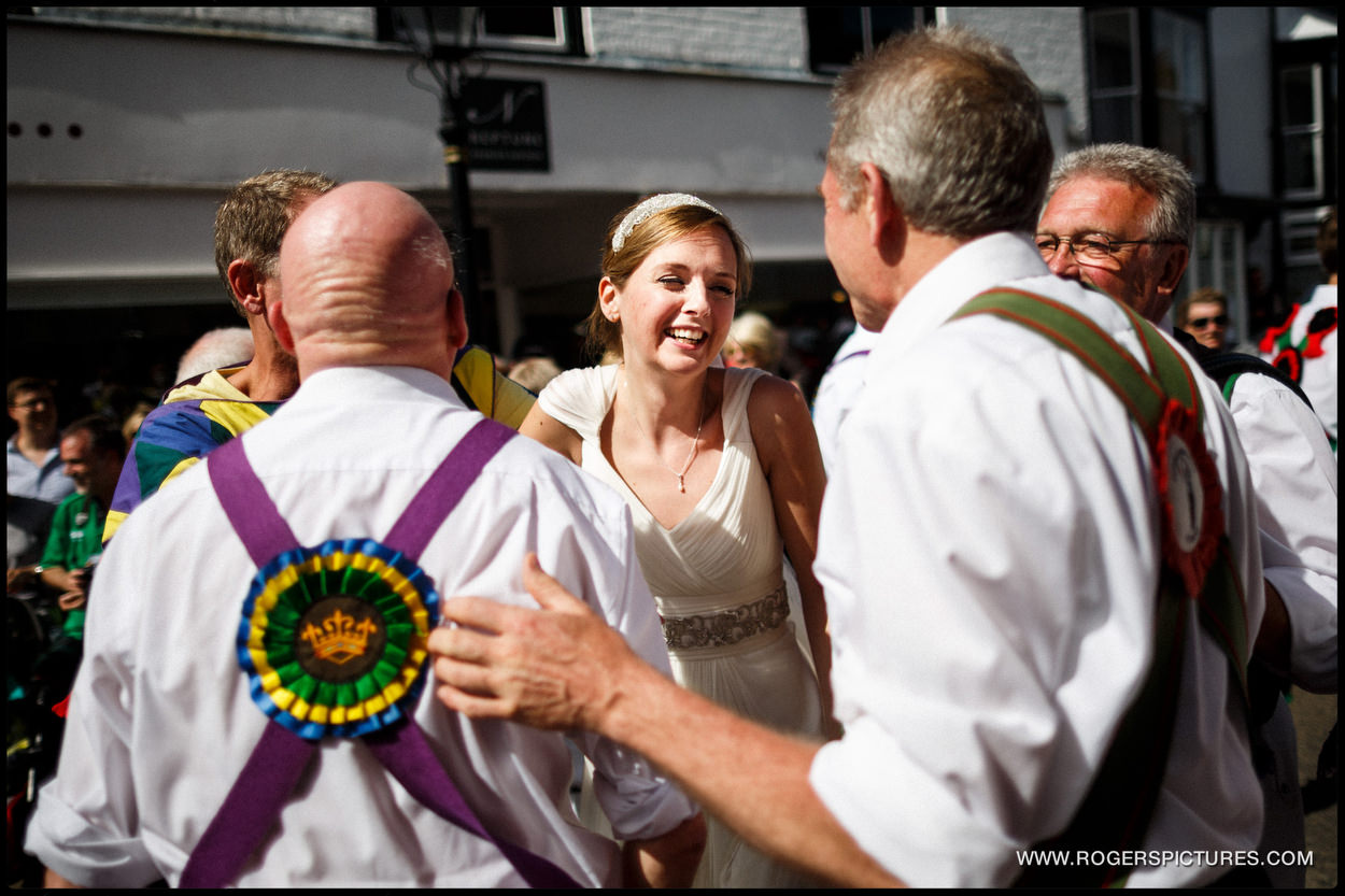 Morris Dancers with a newly married bride in Rye, Sussex