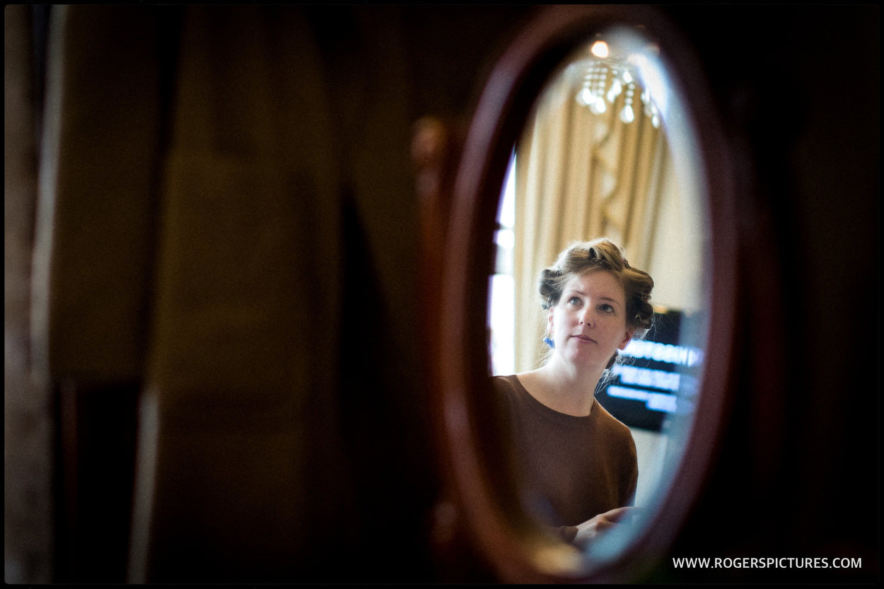 Bride reflected in an oval mirror