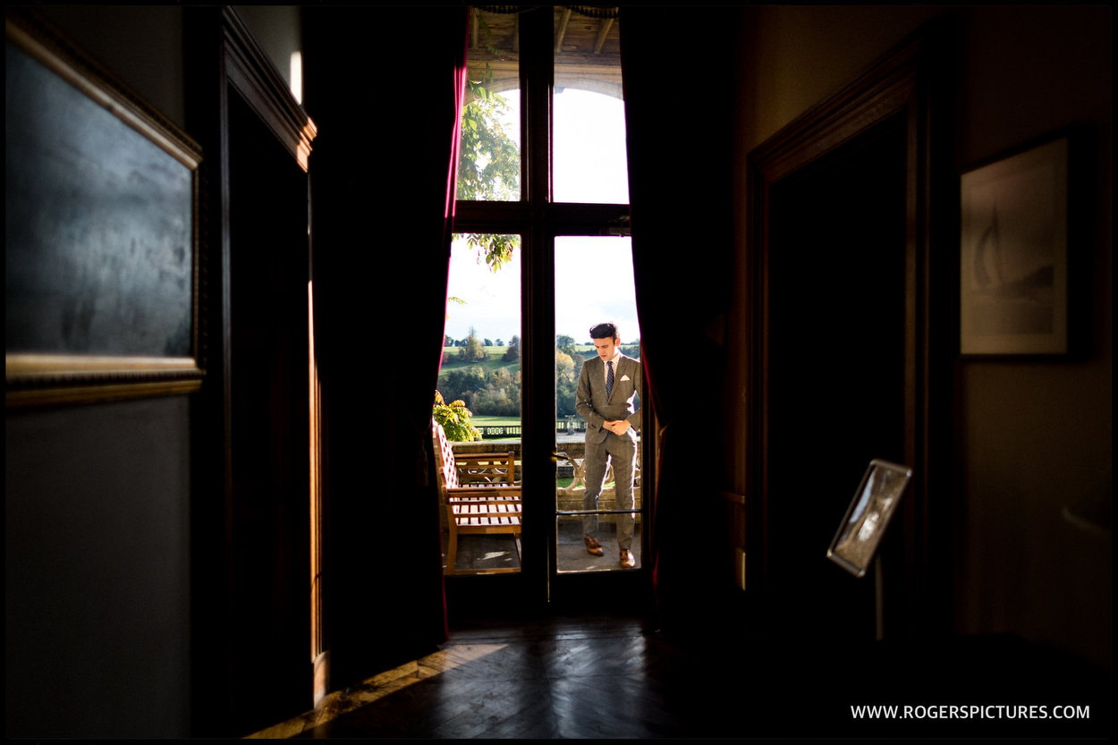 Groom framed in a doorway