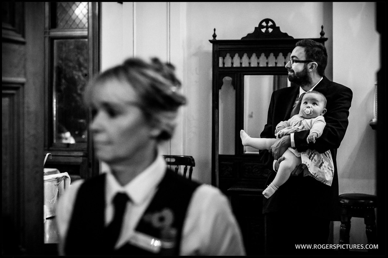 Wedding guest holding a baby