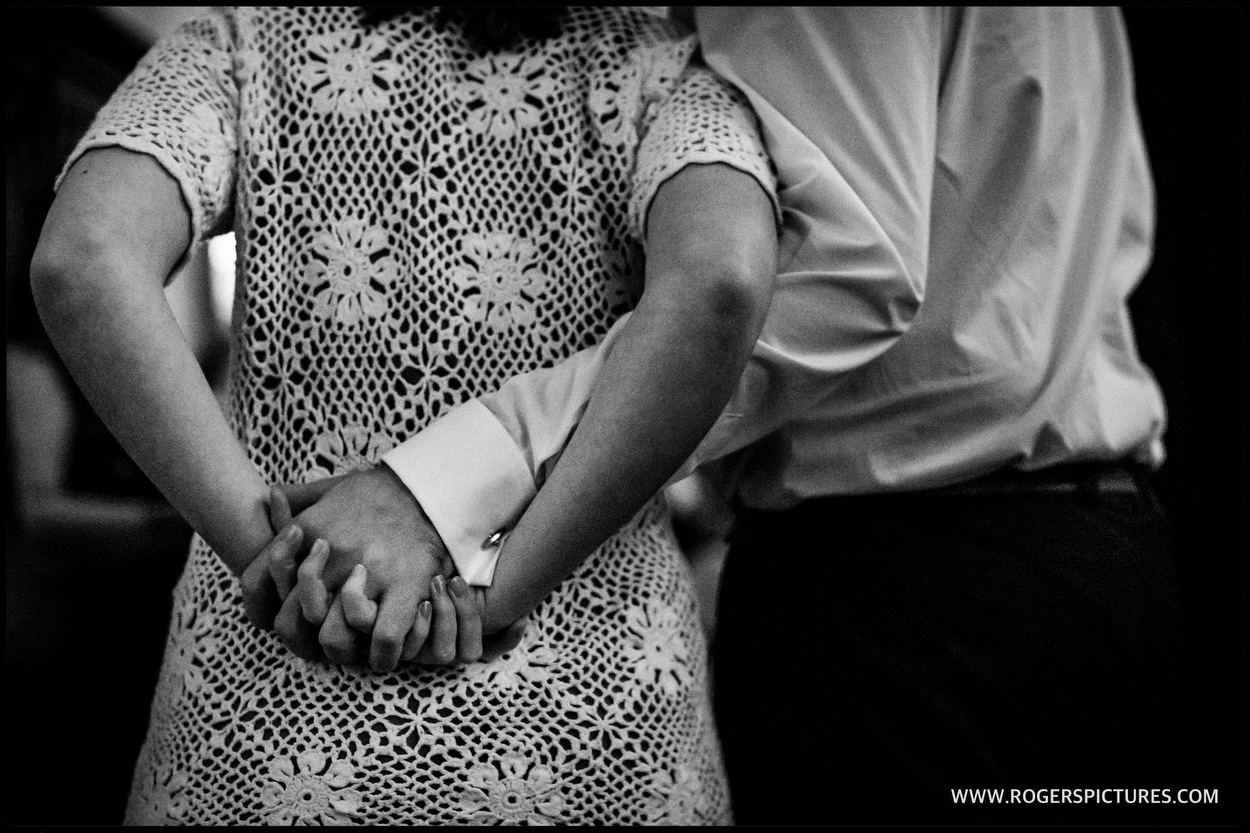 Couple holding hands I do when reception tion