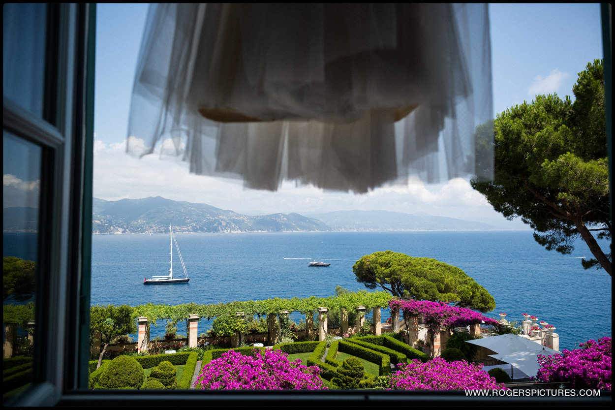 Wedding dress hanging in front of Portofino