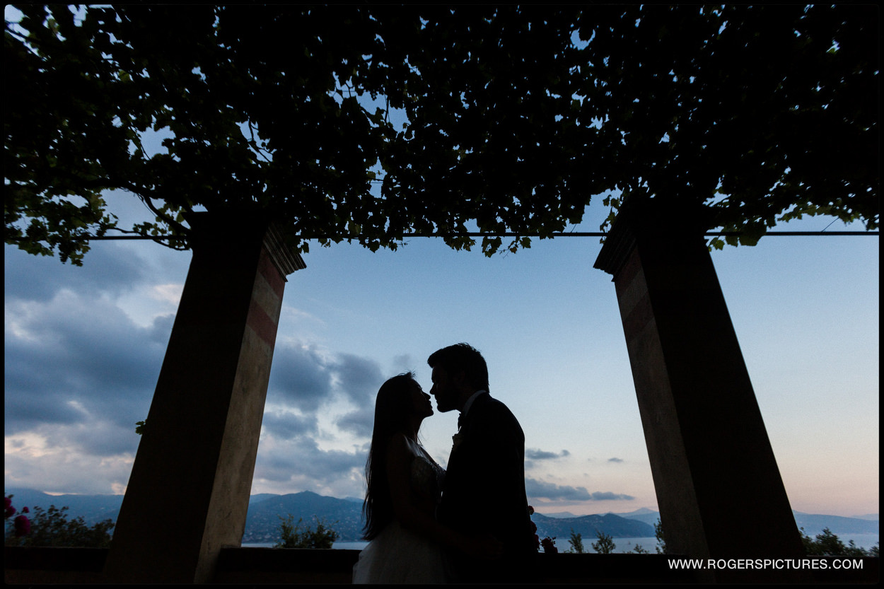 Bride and groom silhouetted in Portofino, Italy