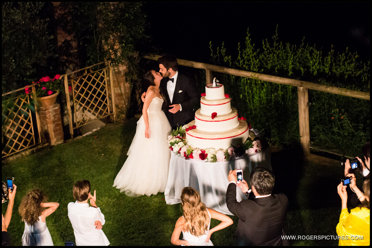 Bride and groom cut wedding cake in Portofino Italy