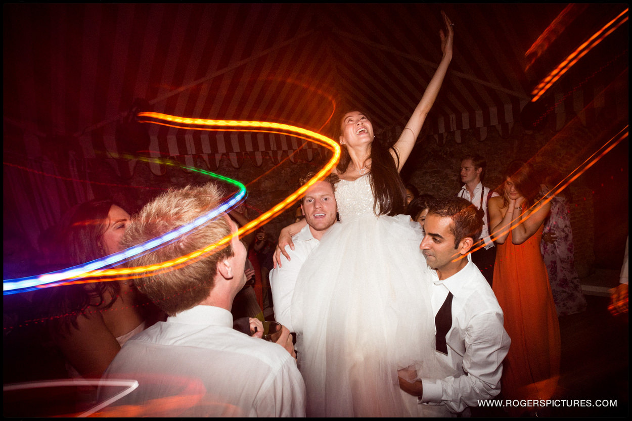 Bride celebrating on the dancefloor in Portofino Italy