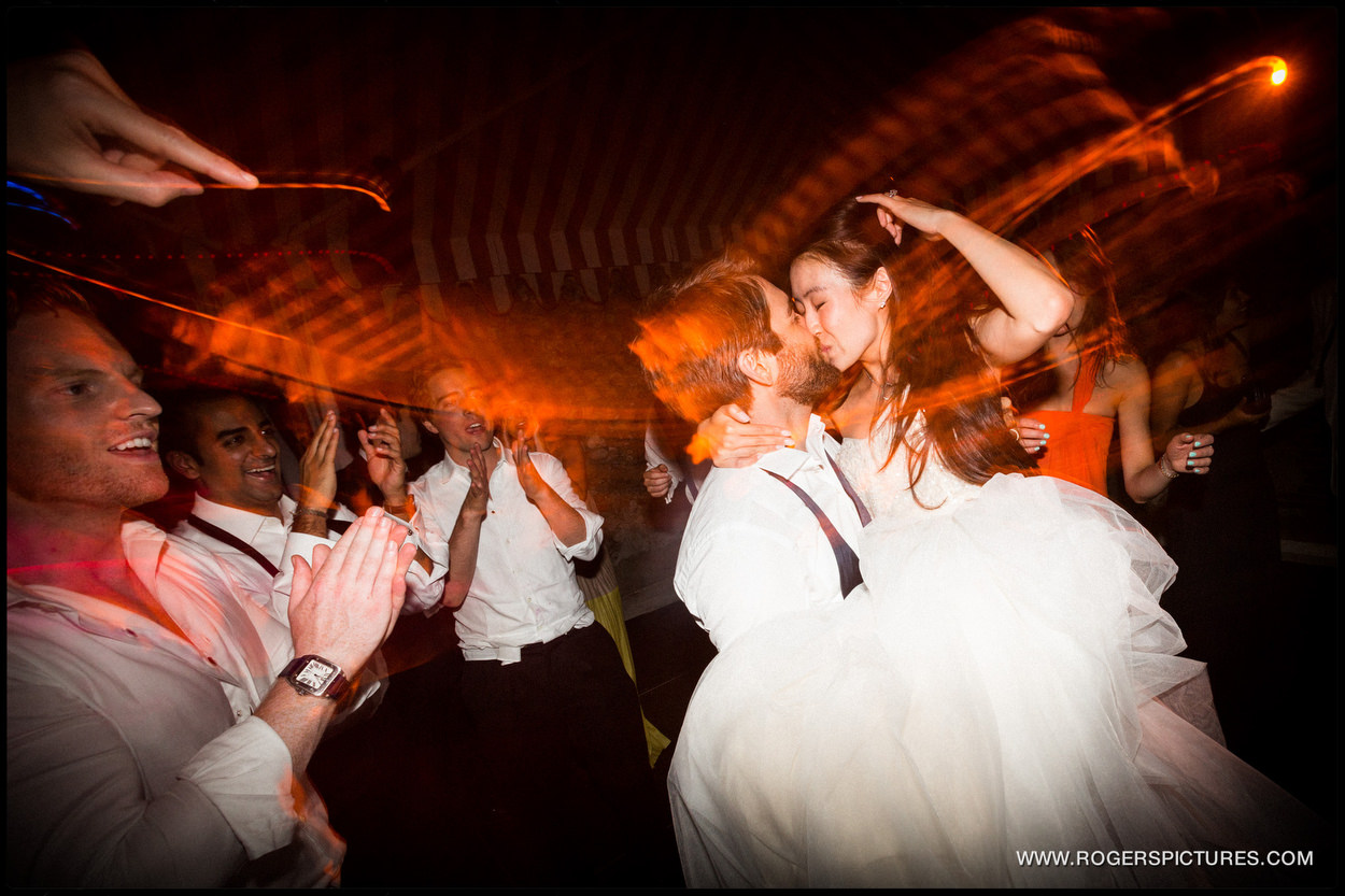 Husband-and-wife celebrate on the dance floor after marrying in Portofino Italy