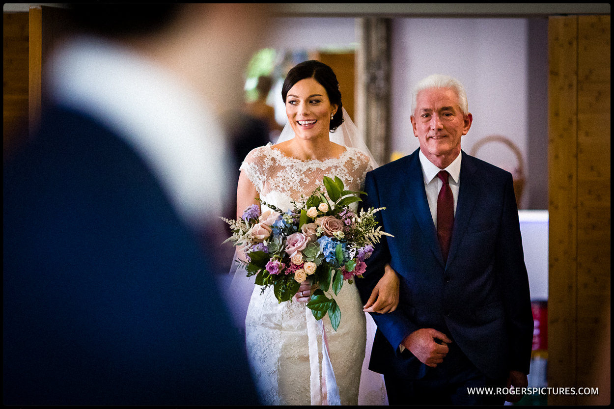 Father walks daughter down the aisle at her wedding