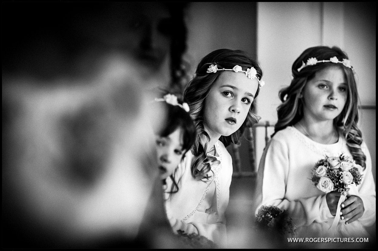 Flower girls at a wedding in black and white