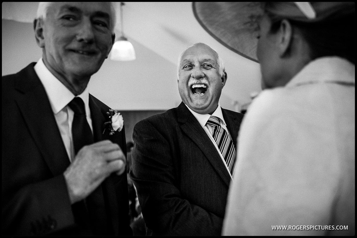 Laughing guest at a wedidng