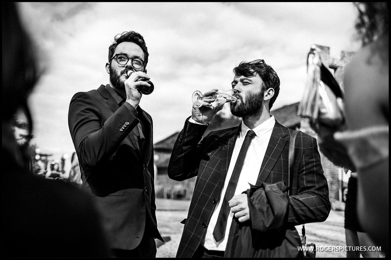 Guests take a drink at a wedding reception