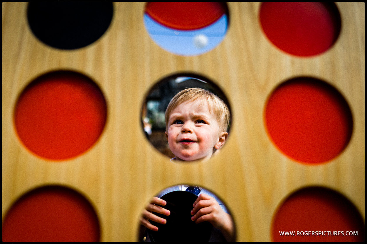 Boy plays giant connect four at a wedding